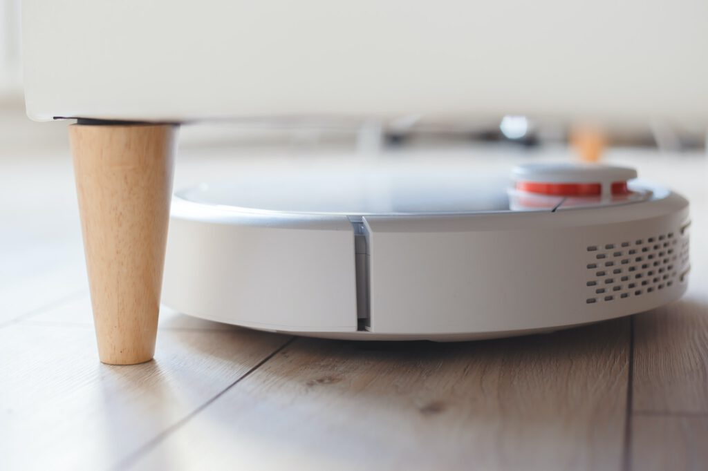 Robot vacuum cleaner vacuuming under the bed